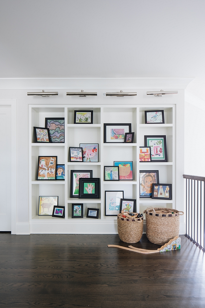 Asymmetrical bookcase This asymmetrical built-in bookcase is perfect to display the kids art, books and such Paint Color is Benjamin Moore Simply White Asymmetrical bookcase #Asymmetricalbookcase #bookcase