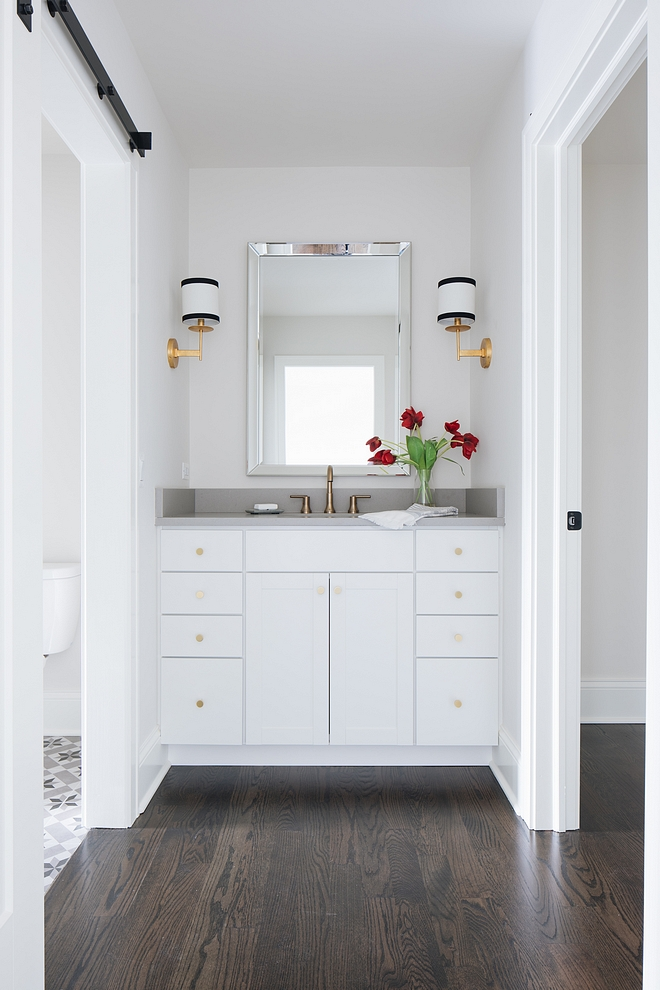 Jack and Jill bathroom This adorable Jack-and-Jill bathroom features an inspiring layout. The first vanity is located just off the first bedroom, then, a large space with the bathtub and cement tile flooring connects with the second vanity and the other bedroom #JackandJillbathroom #bathroom