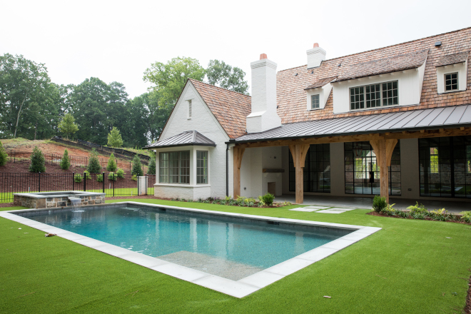 Modern farmhouse backyard with pool
