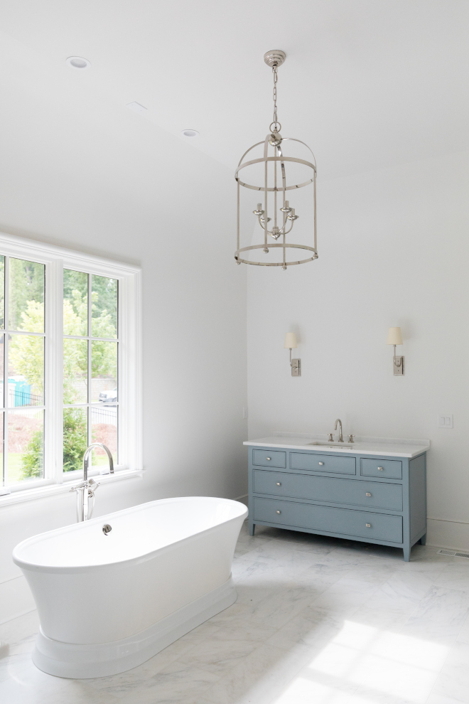 Bathroom with blue gray vanity walls are Sherwin Williams Snowbound #bathroom #masterbathroom #bluevanity #bluegray #SherwinWilliamsSnowbound
