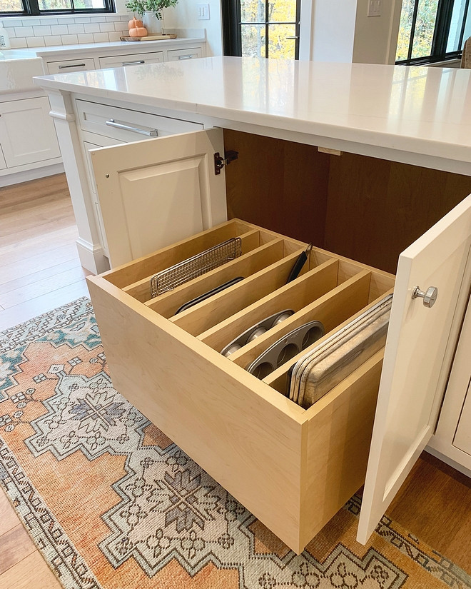 Kitchen Sheet Pan Storage This one of the most brilliant ideas I have seen this year: This kitchen features a pull-out sheet pan drawer. This means more space for your sheet pans and cutting boards and everything stays organized