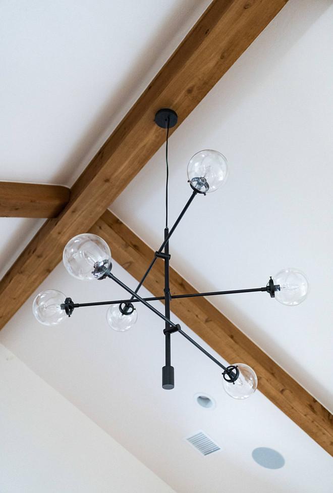 Mid century modern chandelier on vaulted ceiling with Cedar Beams Mid century modern chandelier #Midcenturymodern #modernchandelier