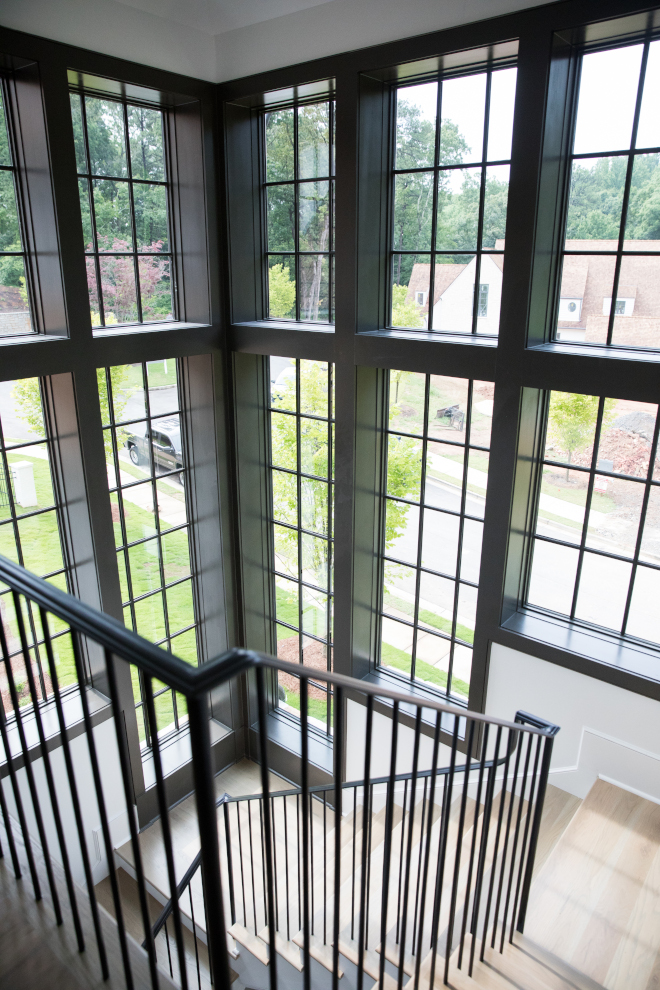 Staircase Black windows tower Staircase tower with floor to ceiling black steel windows Metal railing spindles staircase #Staircase #Staircasetower #tower #floortoceilingwindows #floortoceilingblackwindows #steelwindows