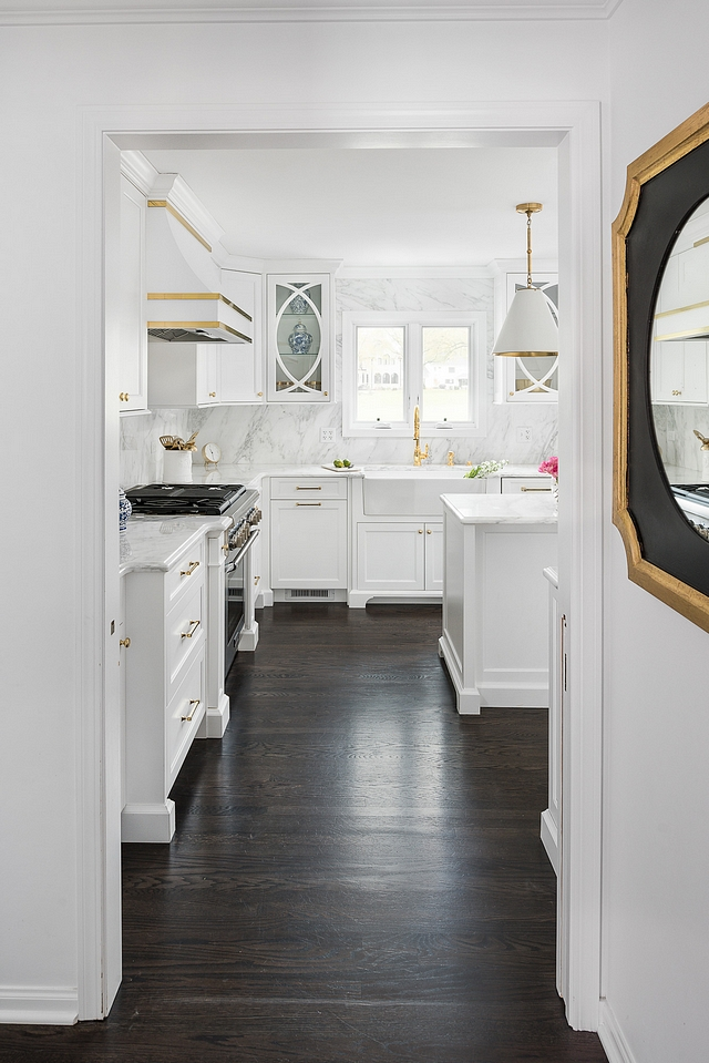 Walls and trim are painted in Benjamin Moore Super White Flooring is Oak hardwood floors with Ebony stain