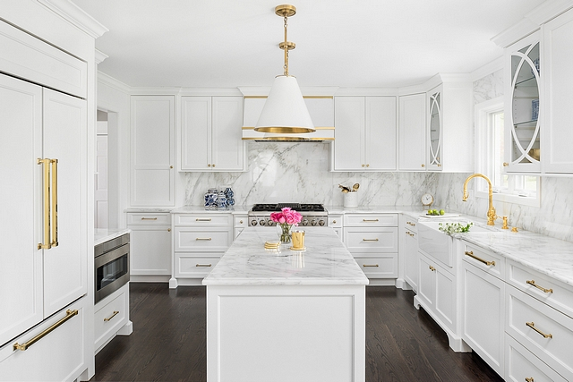Classic white kitchen with white marble countertop white marble slab backsplash white cabinets white kitchen island and dark hardwood flooring #whitekitchen #whitekitchenisland #whitemarble