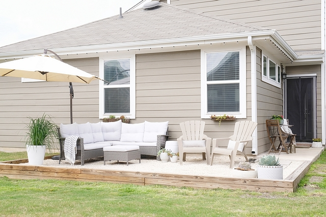 When we moved in, our backyard was just a plain patch of grass. Since we're renting, we worked with our landlord to come up with an affordable solution. With my dad's help, we built this raised gravel patio ourselves #patio #diy