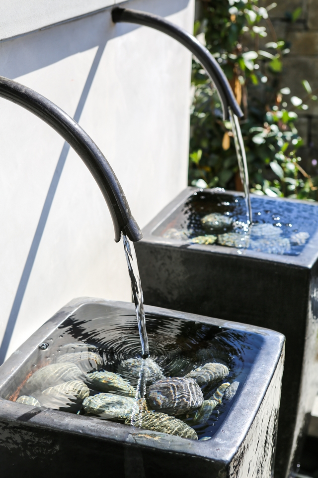 Water Fountain I am loving the rustic yet modern look of these fountains with water spigots #fountain #waterfountain