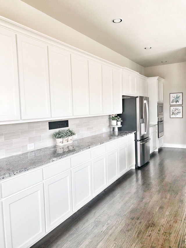 Long Kitchen Cabinet The best part of the kitchen is the long buffet countertop that's perfect for entertaining because we like to host parties. This counter space runs almost 15 feet long so it holds all the food you could eat. #longkitchen #longcabinet #longkitchencabinet