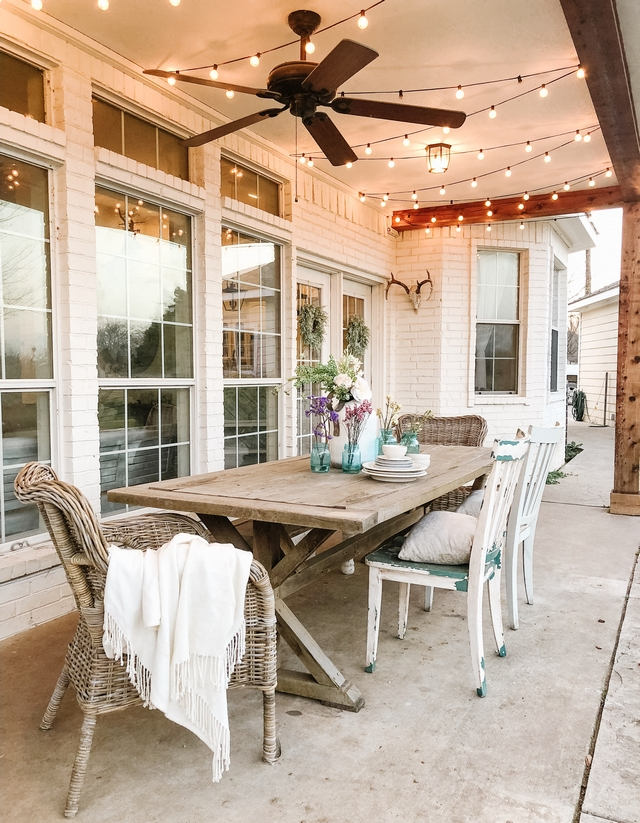 Farmhouse Porch Back Porch with trestle table Farmhouse Porch Back Porch with trestle table, painted brick siding and outdoor string lights #Farmhouse #farmhousePorch #BackPorch #trestletable