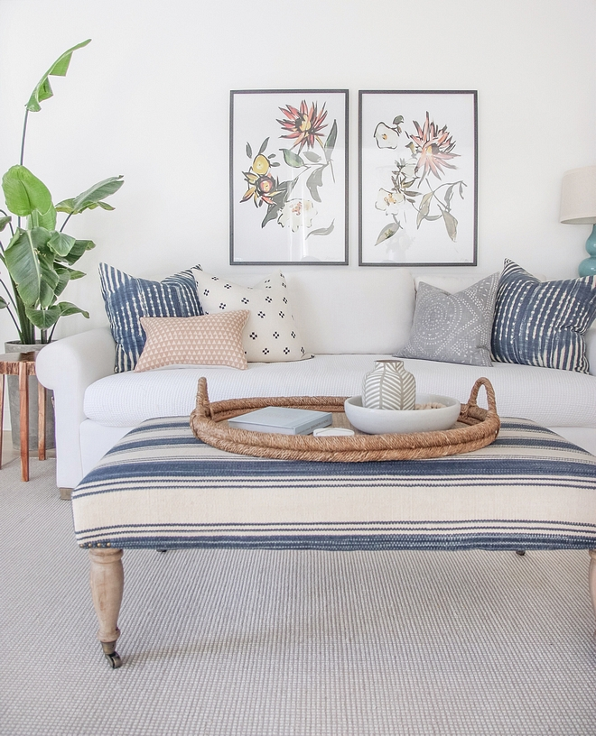Coastal Interiors New coastal interiors This is how a timeless coastal interior design looks like Timeless white linen sofa with hints of striped blue and white decor Coastal Interiors New coastal interiors #CoastalInteriors #Newcoastal #coastal #interiors #whitelinensofa #stripedblueandwhite #decor