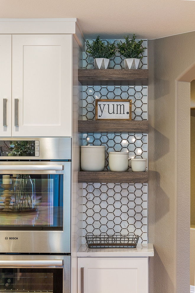 Kitchen floating shelves with accent tile Honeycomb Asian Statuary Marble with Athens Gray Line #Kitchen #floatingshelves #accenttile #Honeycombtile #AsianStatuary #Marble #tile