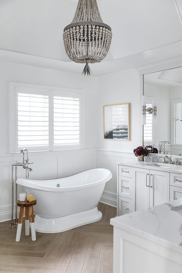 White bathroom with wainscoting White bathroom with wainscoting and wood-looking tile in herringbone pattern White bathroom with wainscoting White bathroom with wainscoting #Whitebathroom #bathroomwainscoting