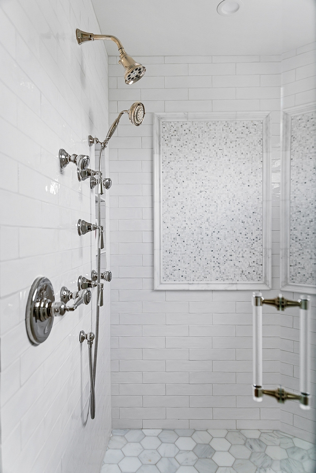 Shower Tile In addition to the sparkle the mosaics add, we dressed up a classic white subway tile with beautiful marble hex tile on the shower floor, gleaming polished nickel fixtures and a stunning lucite door handle #shower #tile