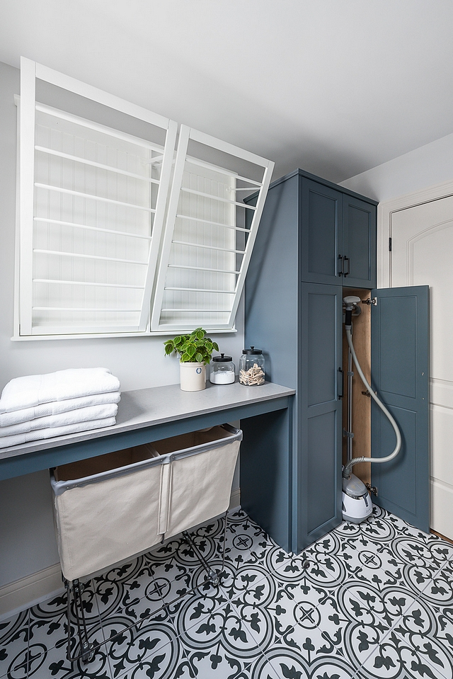"Storage Cabinet Ideas This corner behind the door was just a place for piling up all of the tall household items that wouldn't fit elsewhere. Now, this ""bottom-less"" cabinet is the perfect place to hold a clothes steamer or vacuum that you can simply roll right out and use when needed #laundryroom #Storage #Cabinet"