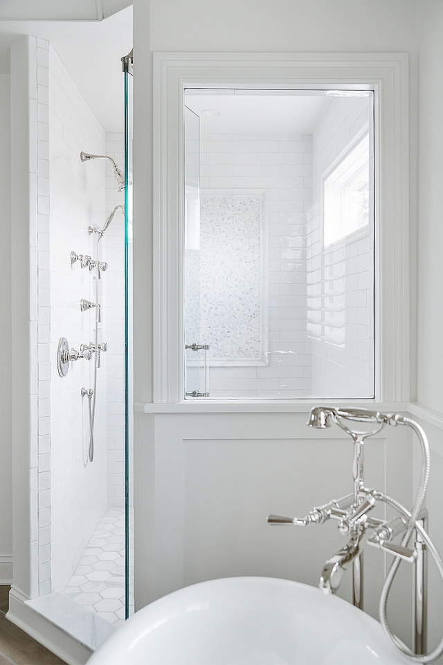 Shower Window A  large window was added facing the tub to allow you to see through to the gorgeous mosaic tile on the back wall #showerwindow #shower #window