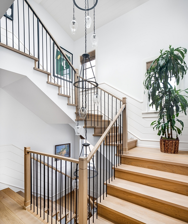 Horizontal shiplap wainscoting The staircase features White Oak treads, White Oak posts and railing with metal spindles. Walls are horizontal shiplap wainscoting #horizontalshiplap #shiplapwainscoting #staircase #staircaseshiplap #staircasewainscoting