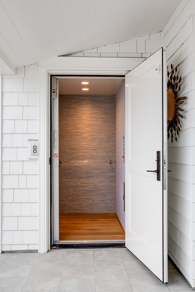 An elevator leads you to the rooftop. The elevator features Hartman and Forbes wallpaper and an acrylic handle #residentialelevator #elevator