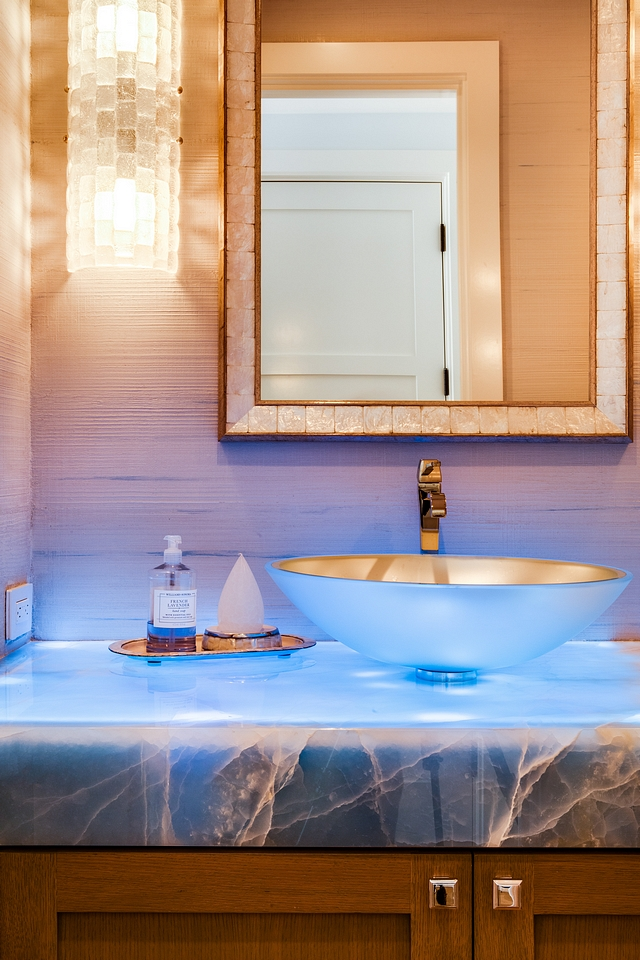 Blue Onyx waterfall counter illuminated by light strips installed under countertop Blue Onyx waterfall counter Blue Onyx waterfall countertop Blue Onyx waterfall counter ideas #BlueOnyx #waterfallcountertop #countertop