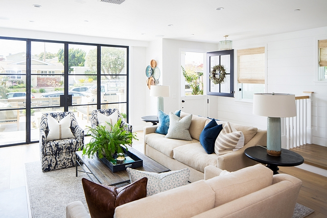 Living room Continuing the builder's balance of clean, modern design and eclectic finishes, the designer brought in staples such as neutral sofas and reclaimed furnishings while incorporating patterns with a bohemian flair and earthy-tone accents #livingroom #decor #interiordesign