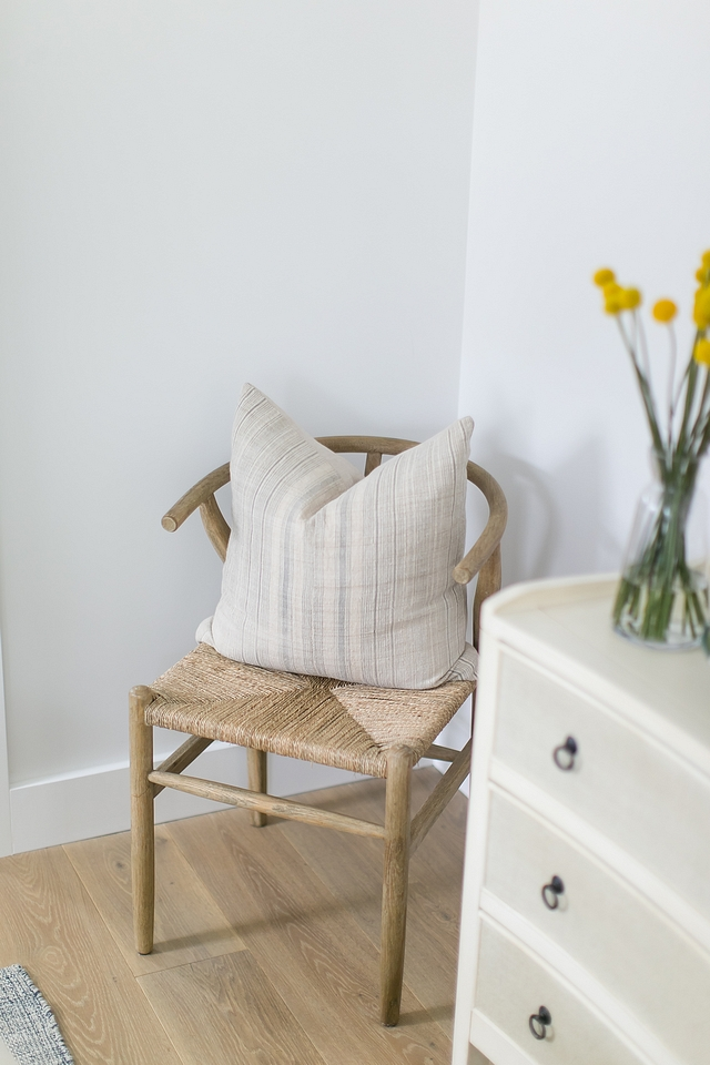 Wishbone style accent chair with vintage pillow