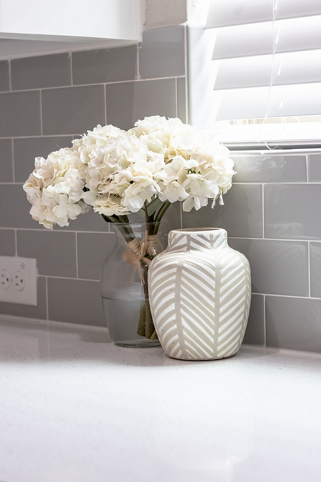 Kitchen backsplash The same grey subway tile continues from the kitchen into the pantry Grey tile #kitchen #greytile