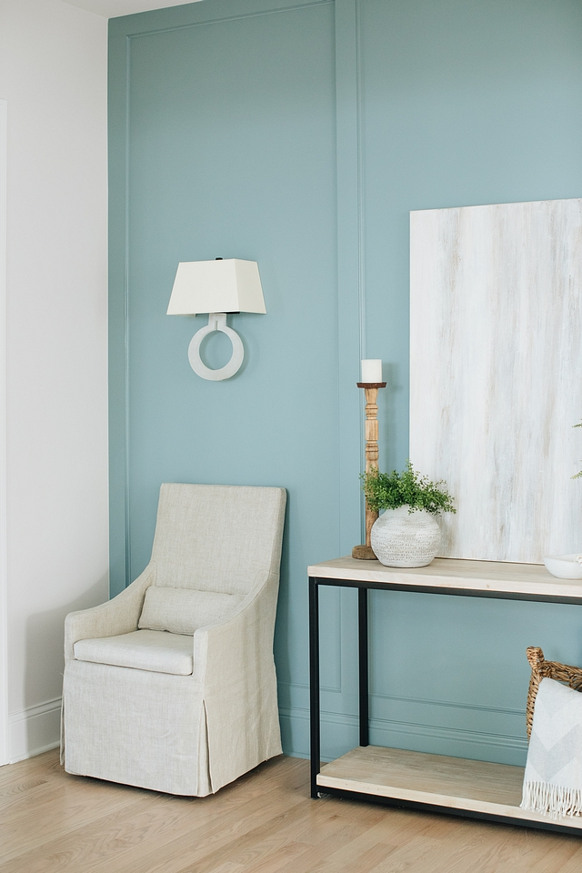 Alabaster Sconce Alabaster Sconce on paneled wall painted in a Benjamin Moore aqua blue color #AlabasterSconce #Alabaster #Sconce #paneledwall #BenjaminMoore #aquapaintcolor #bluecolor