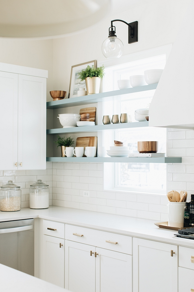 Kitchen Floating Shelves I knew I wanted the element of floating shelves in this kitchen but couldn't really find a good spot. The horizontal lines on the windows inspired me to take the shelves all the way across the windows on the main wall of the kitchen #floatingshelves #kitchenshleves