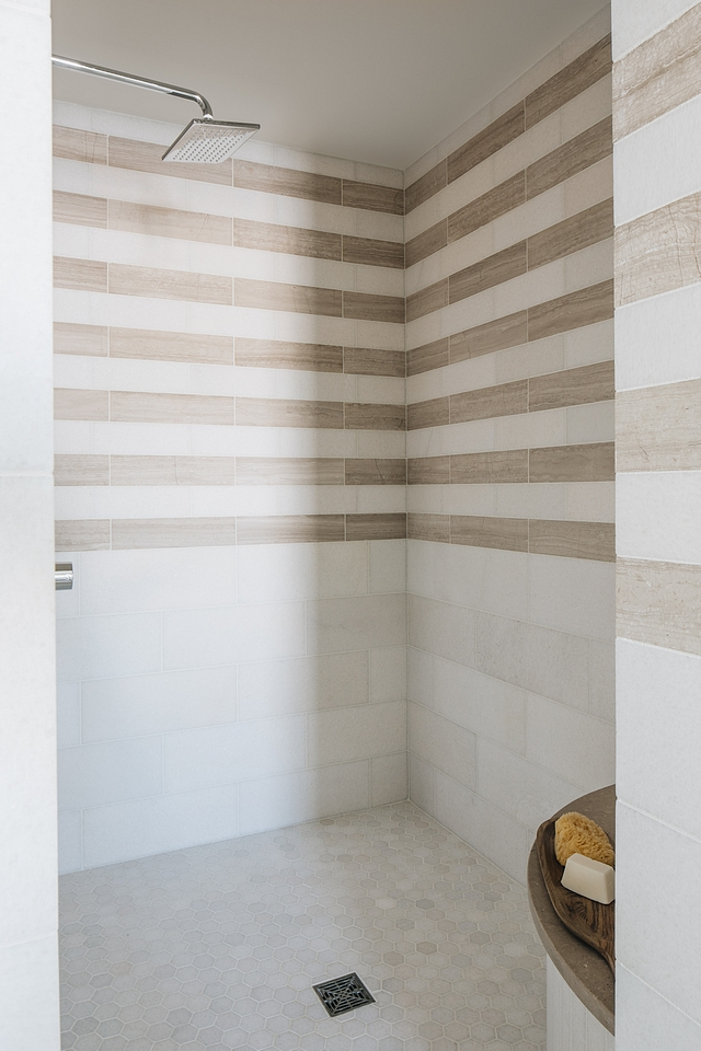 Shower tile I loved creating the stripe pattern in the shower to look like wallpaper above a chair rail. There are so many details in this master suite but the shower tile detail is my favorite #showertile #showertilepattern #tilepattern #tile