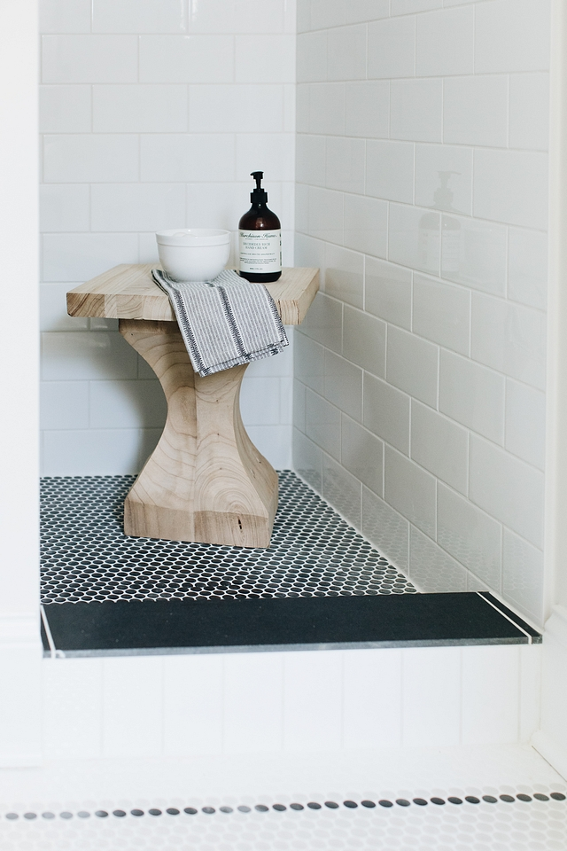 Shower features black Penny tile on shower pan and a white subway tile on walls #showertile #shower #tile #showerpan #walltile #pennytile #subwaytile