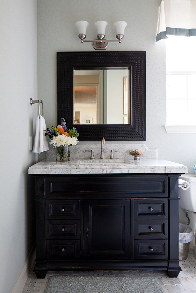 Black vanity, painted in Benjamin Moore Onyx, with a distressed finish Black vanity, painted in Benjamin Moore Onyx, with a distressed finish Benjamin Moore Onyx #BenjaminMooreOnyx #blackvanity #distressedvanity
