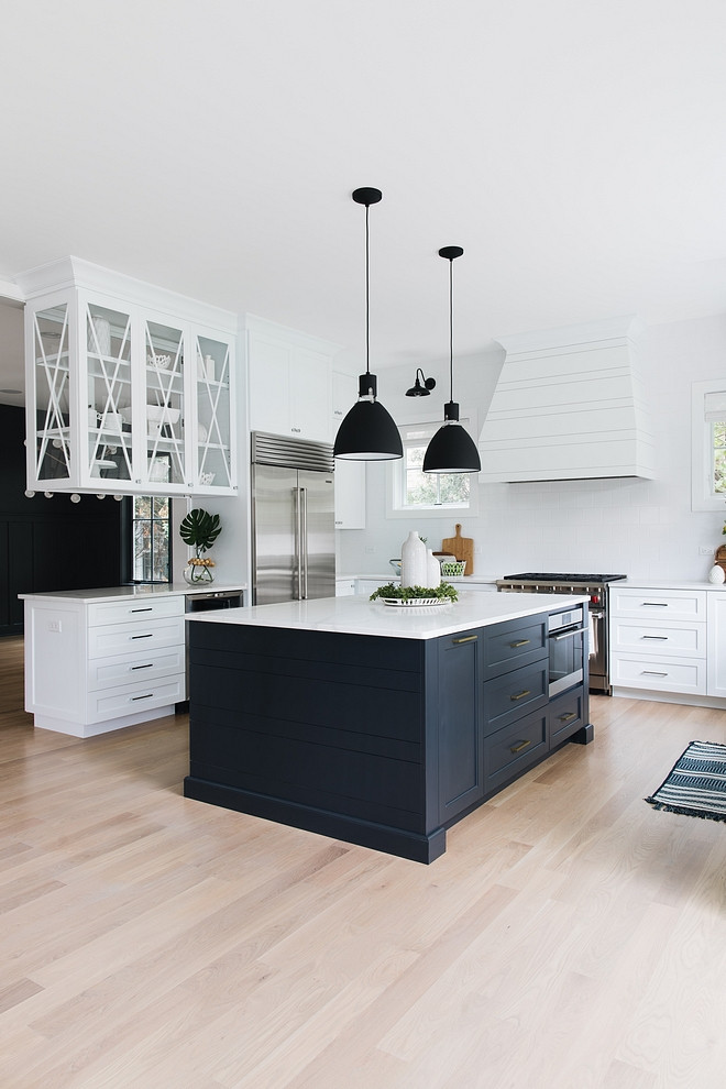 """Black and white kitchen white kitchen with black island Nothing feels more """"modern farmhouse"""" than black and white and this combo also works well on kitchens Black and white kitchen paint color Color scheme Color palette Paint Colors #modernfarmhouse #farmhousekitchen #modernfarmhousekitchen #blackandwhite"""