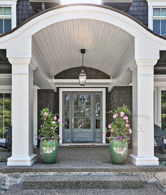 Arched porch ceiling The porch features custom columns and arched ceiling The grey front door with sidelights was custom-painted in a dark grey shade #porch #frontporch #porchcolumns #frontdoor #Archedporchceiling #porchceiling #archedporch