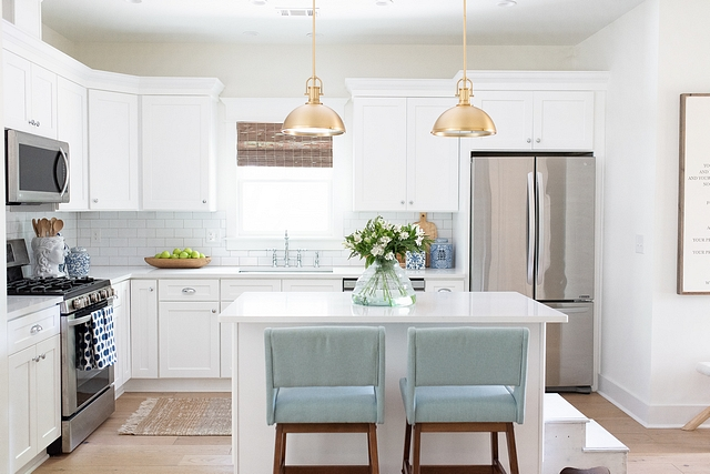 White kitchen I always have loved a clean white kitchen, so I was set on having white cabinetry and countertops. We went with flat panel, shaker cabinets accented by 3x6 white subway tile #whitekitchen #shakercabinets #whitekitchenshakercabinet #subwaytile