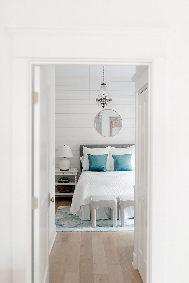 Shiplap bedroom wall I was looking for a way to cozy-up our guest bedroom, so we recently added this shiplap accent wall and hung the round mirror over the bed #bedroom #shiplap #guestbedroom #shiplapwall