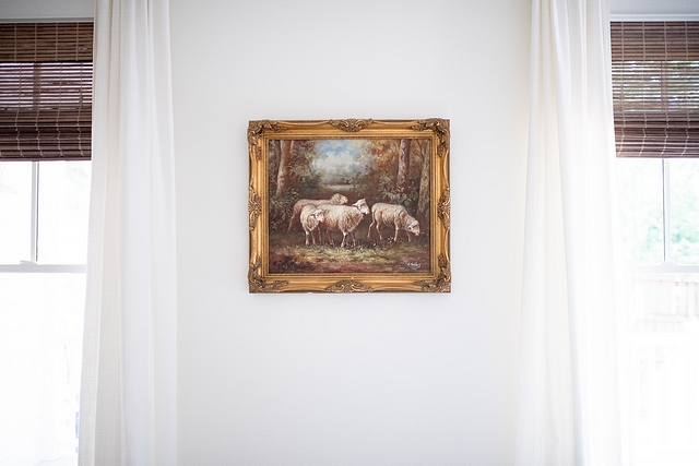 The design inspiration for our bedroom is centered around this antique oil painting of sheep