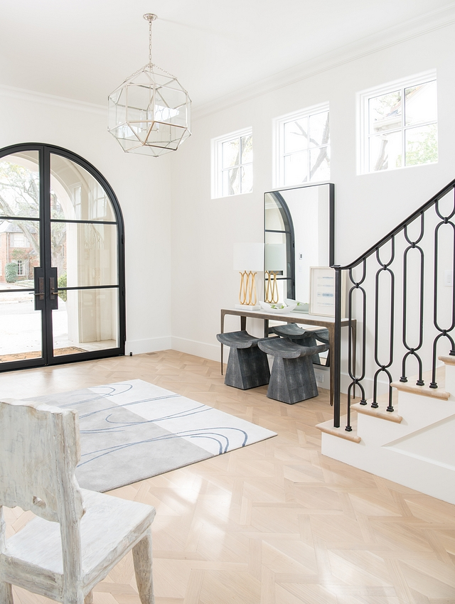 Benjamin Moore White Dove with very light White Oak hardwood flooring and arched black metal and glass front door Benjamin Moore White Dove #BenjaminMooreWhiteDove #BenjaminMoore