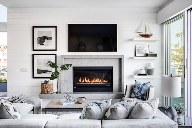 Sleek marble fireplace with shiplap accent wall Living room featuring a Sleek marble fireplace with shiplap accent wall Sleek marble fireplace with shiplap accent wall #Sleekmarblefireplace #fireplace #marblefireplace #shiplap #accentwall