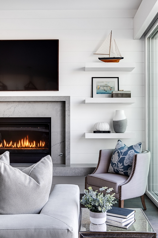 Chunky floating shelves The fireplace is flanked by a pair of framed artwork and chunky white floating shelves Chunky floating shelves Chunky floating shelves #Chunkyfloatingshelves #floatingshelves