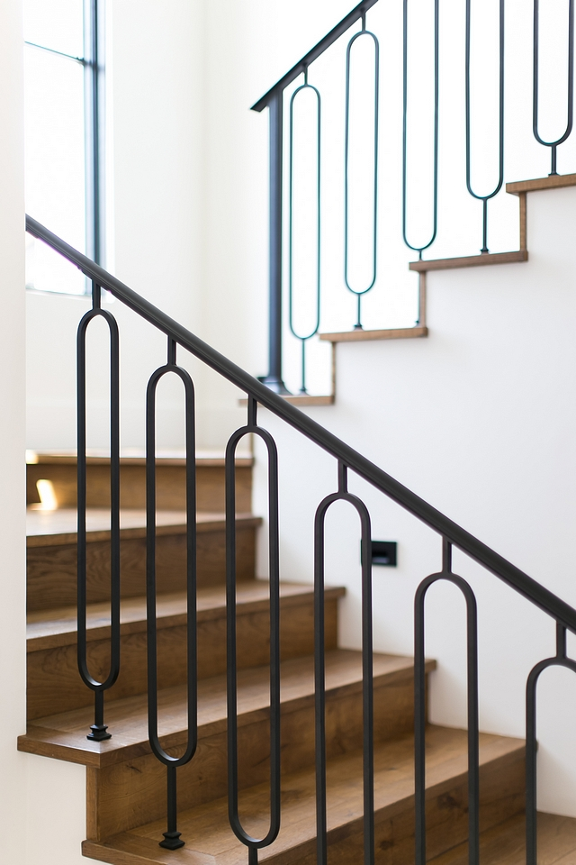 The staircase features custom-designed metal railing and White Oak threads #staircase #interiors #interiordesign #homedecor #homes #metalrailing #WhiteOakthreads