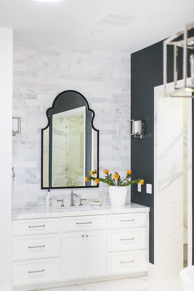 Arched Mirror Bathroom with white marble subway tile backsplash accentuated by a black arched mirror #archedmirror #bathroom #mirror #bathroommirror