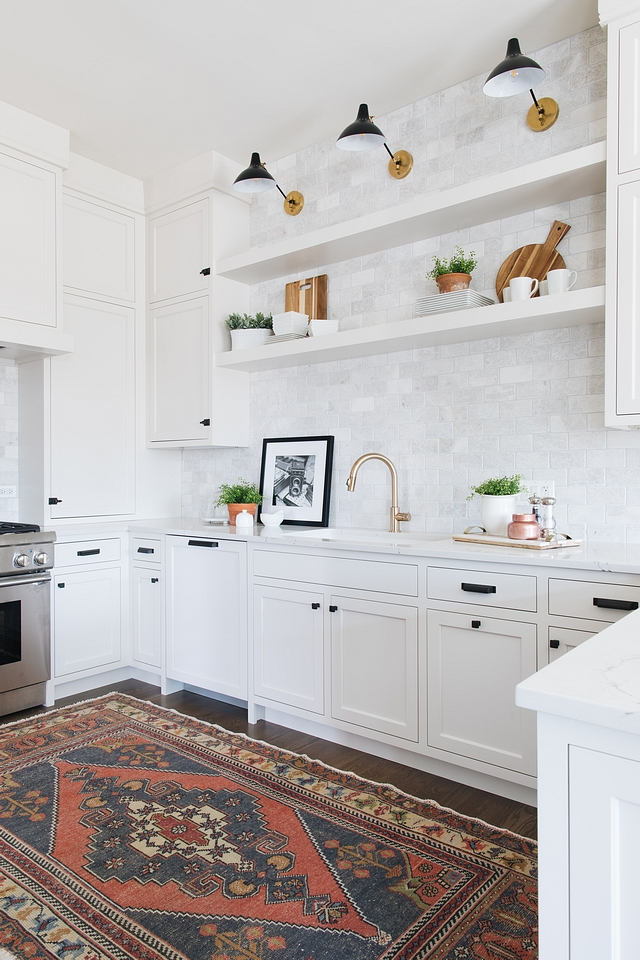 Kitchen Shelves Some people will actually use kitchen floating shelves to hold their utility items and grab at them like a chef at a restaurant. I however, like to save that stuff for closed cabinets and use the floating shelves as an area to style like a bookcase. Using frames leaning and stacked up against each other creates a really nice look along side your more traditional kitchen items #kitchenshelves