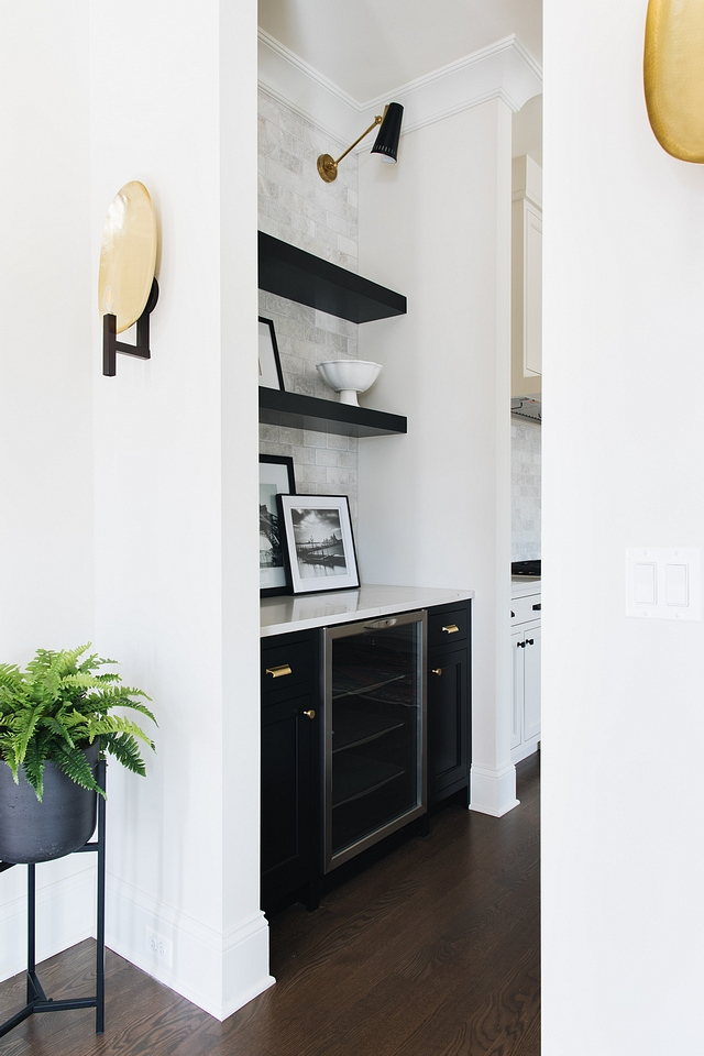 Black Butlers Pantry The butler's pantry features black cabinetry and black floating shelves, painted in Benjamin Moore Black #BenjaminMooreBlack #blackbutlerspantry #blackshelves #blackfloatingshelves