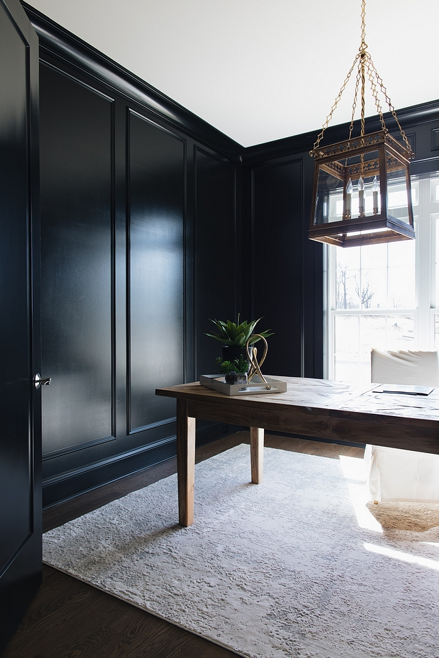 Benjamin Moore Black The home office features extensive millwork using panel molding and then having the whole room painted semi-gloss of Benjamin Moore Black - this works because the room has a southern exposure and fills with light. It creates a moody space that catches your eye as you walk down the hall #blackinteriors #blackBenjamionMoore #BenjaminMoore #Blackpaintcolor
