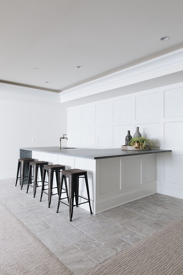 Bar Bar Countertop with waterfall edge - Caesarstone Rugged Concrete and square board and batten wall paneling Basement Bar Basement #Bar #Basement #Countertop #waterfalledgecountertop #CaesarstoneRuggedConcrete #squareboardandbatten #wallpaneling