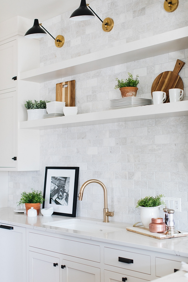 Backsplash Tile Kitchen backsplash is Carrara marble tile to ceiling from The Tile Shop Meram Blanc Tumbled #backsplashtile #backsplash #tile