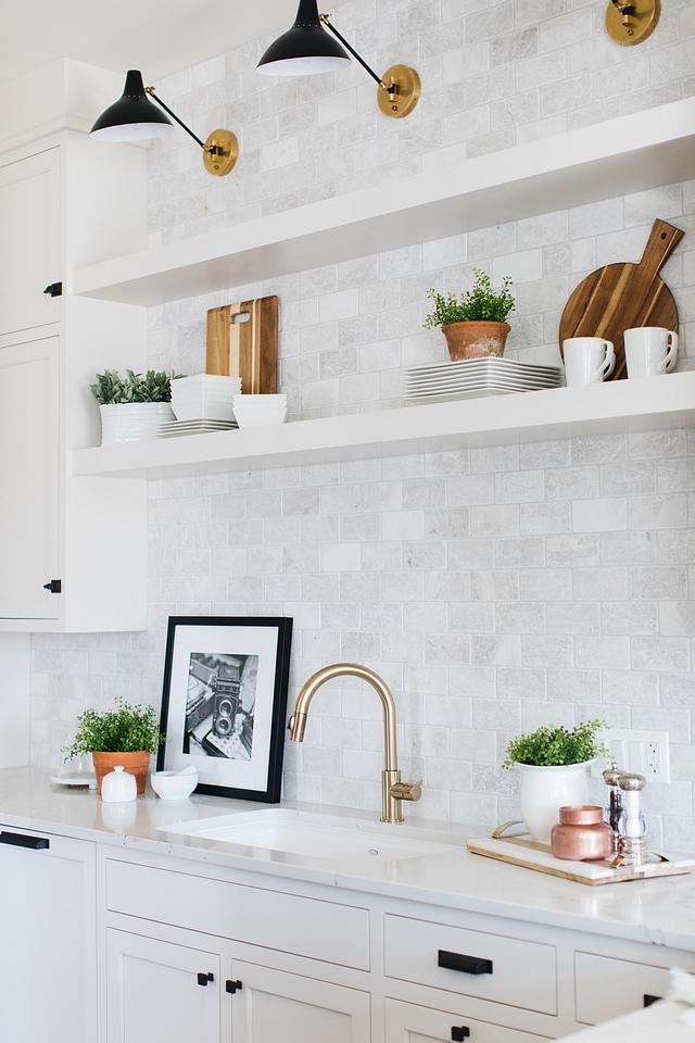Backsplash Tile Kitchen backsplash is Carrara marble tile to ceiling from The Tile Shop Meram Blanc Tumbled #backsplashtile #backsplash #tile