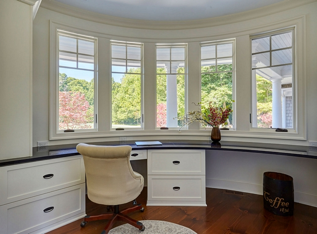 Curved Wall Curved wall home office Set inside the curved turret is a home office with traditional shaker cabinetry and dark stone countertops #CurvedWall #homeoffice