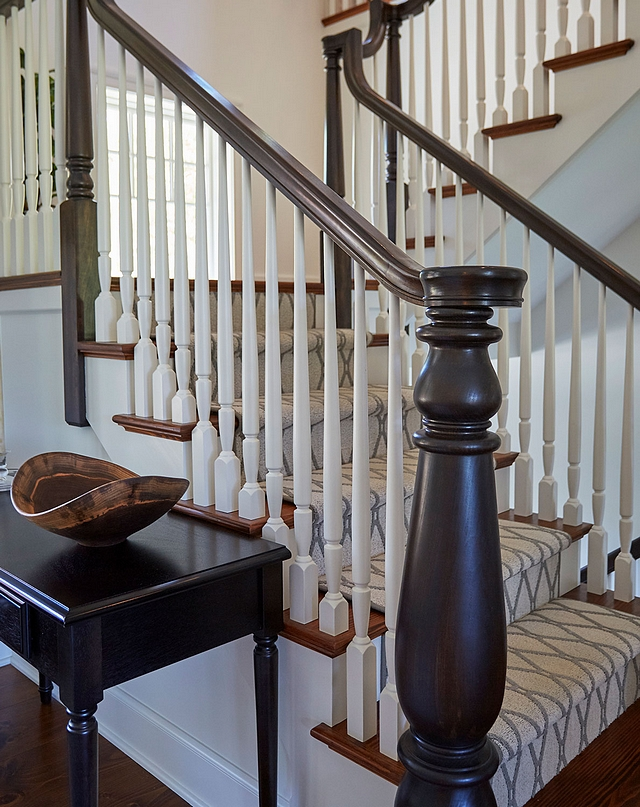 "Staircase The staircase was custom designed and it features open end swell step with 7"" custom starting newel post, . 1-1/4"" painted balusters, Poplar handrail stained in a dark brown color. The staircase treads are Southern yellow pine with a custom carpet runner #staircase #treads #baluster #newelpost"
