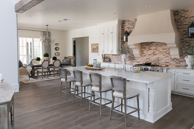 French Farmhouse Kitchen Combining brick backsplash with White Marble countertops, this French-farmhouse kitchen feels connected with the rest of the house and it features a timeless design #Frenchfarmhouse #Frenchkitchen #Farmhosuekitchen #brickbacksplash #whitemarble #countertop #timelesskitchendesign