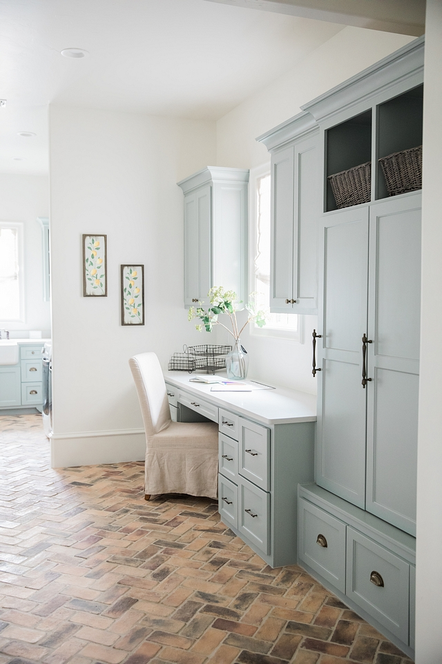 Silvermist by Sherwin Williams Silvermist by Sherwin Williams This laundry room/mudroom space is a dream, starting with the cabinet paint color, Silvermist by Sherwin Williams, and the herringbone brick flooring Silvermist by Sherwin Williams #SilvermistbySherwinWilliams